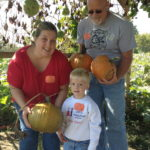 Field Trip Family Picking Pumpkins