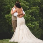 bride and groom hug after first look