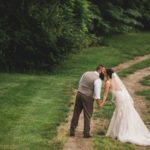 bride and groom wedding photo on dirt road