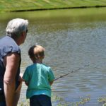 dad and son fishing at faulkner's ranch