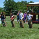 sack races at Action Mailing picnic at Faulkner's Ranch