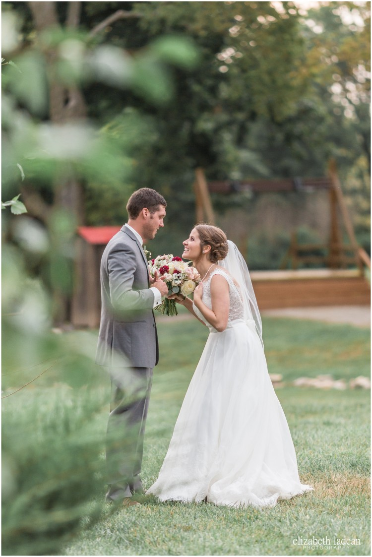 bride and groom in grassy area before wedding