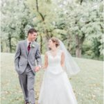 bride and groom wedding photo with trees blooming