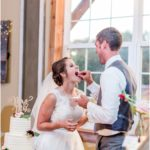 bride and groom eating cake at indoor reception area