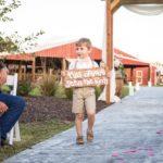 Ring bearer at outdoor wedding in Kansas City at Faulkner's Ranch
