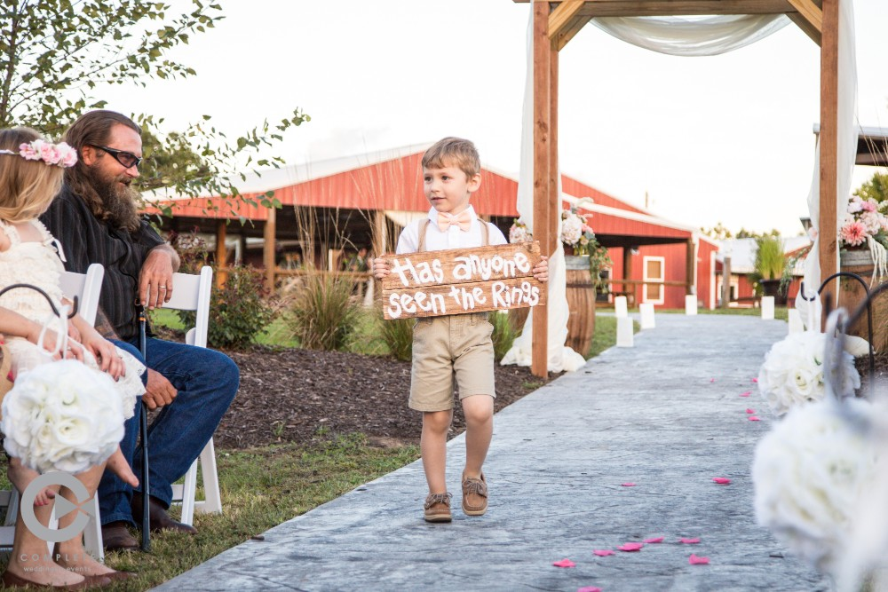 Ring bearer at outdoor wedding in Kansas City at Faulkner's Ranch
