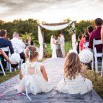 Flower girls in isle at outdoor wedding location in Kansas City