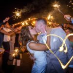 Couple kissing at outdoor wedding in KC